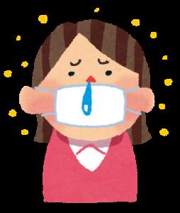 花粉症で鼻水を垂らす女性